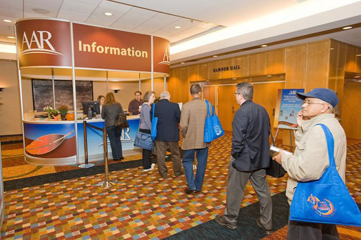 Members line up with their questions at the AAR Information Booth.