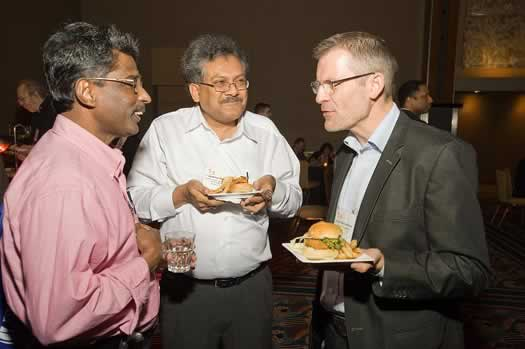 Members chat over food and drinks at the Welcome Reception.