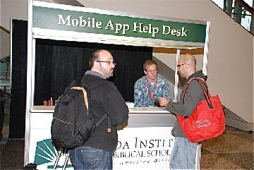 AAR staff assist attendees with the Mobile App.