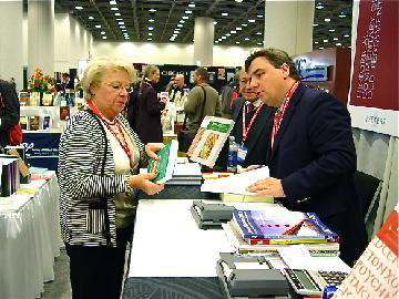 Attendees browse the busy Exhibit Hall.